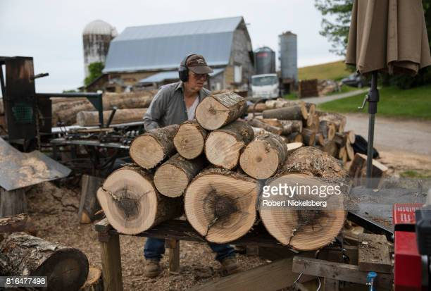 Robert Marble splits firewood June 29 2017 on his converted dairy farm in Charlotte Vermont Marble is a firewood supplier who has cut and sold over...