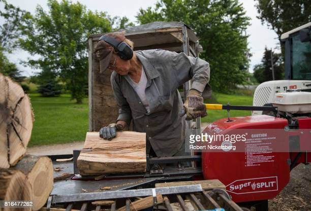 Robert Marble splits firewood June 29 2017 on his converted farm in Charlotte Vermont Marble is a firewood supplier who has cut and sold over 1100...