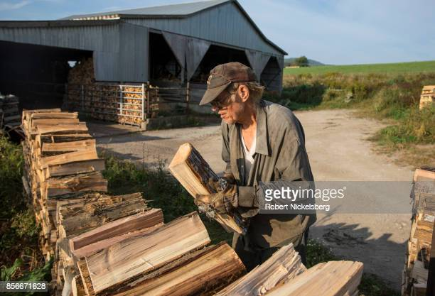 Robert Marble stacks firewood on his converted dairy farm in Charlotte Vermont September 26 2017 Marble is a firewood supplier who has cut and sold...