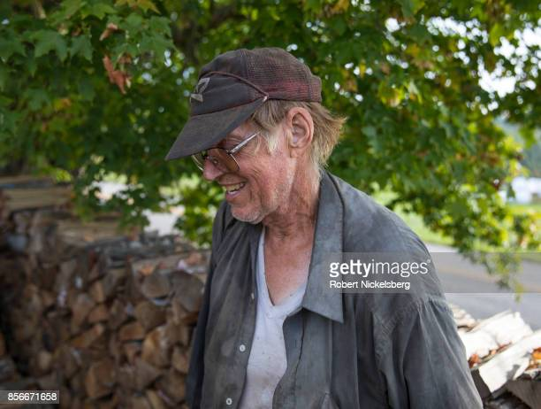 Robert Marble stacks firewood on his converted dairy farm in Charlotte, Vermont, September 26, 2017. Marble is a firewood supplier who has cut and...
