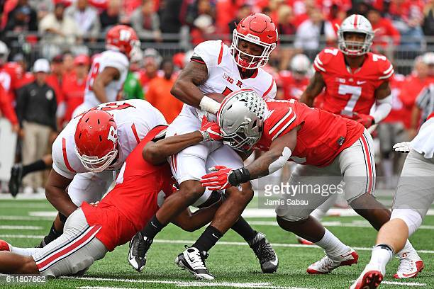 Robert Martin of the Rutgers Scarlet Knights is tackled before the line of scrimmage by Chris Worley of the Ohio State Buckeyes and Raekwon McMillan...