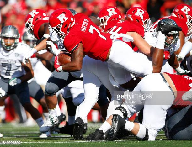 Robert Martin of the Rutgers Scarlet Knights is upended by the Eastern Michigan Eagles defense during the first quarter of a game on September 9 2017...