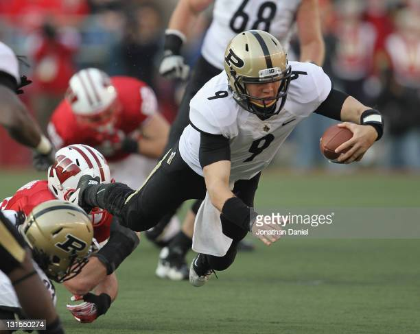 Robert Marve of the Purdue Boilermakers is brought down by Ethan Armstrong of the Wiscons Badgers at Camp Randall Stadium on November 5, 2011 in...