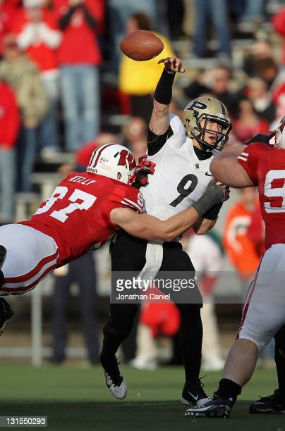 Robert Marve of the Purdue Boilermakers is hit while trying to pass by Brendan Kelly of the Wiscons Badgers at Camp Randall Stadium on November 5...