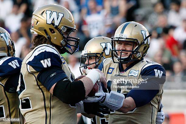 Robert Marve of the Winnipeg Blue Bombers celebrates his first quarter touchdown with teammate Steve Morley during the CFL game against the Montreal...