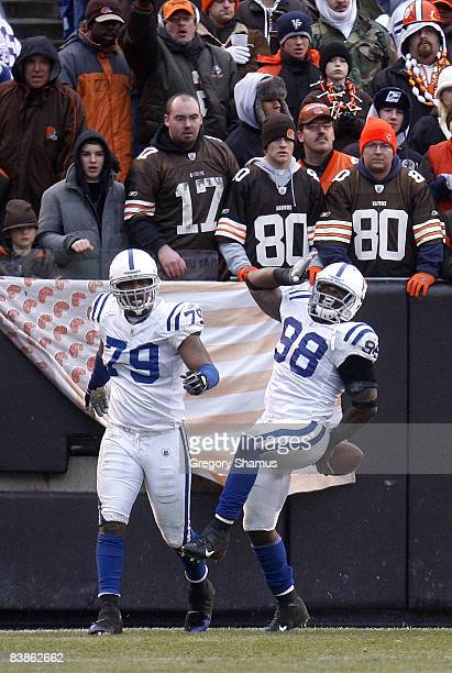 Robert Mathis of the Indianapolis Colts celebrates a fourth quarter touchdown with Raheem Brock in front of Cleveland Browns fans on November 30 2008...