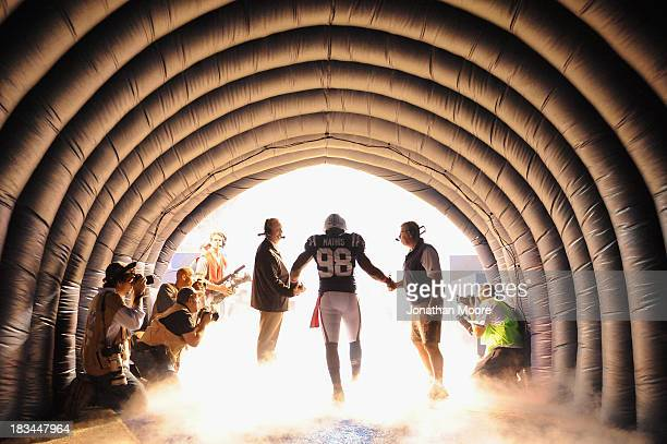 Robert Mathis of the Indianapolis Colts runs onto the field before a game against the Seattle Seahawks at Lucas Oil Stadium on October 6 2013 in...