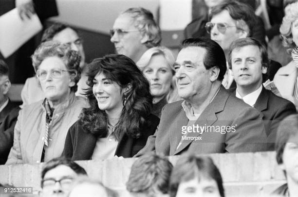 Robert Maxwell and his daughter Ghislaine watch the Oxford v Brighton football match, 13th October 1984.