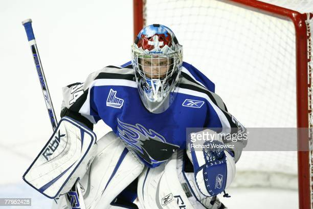 Robert Mayer of the Saint John Sea Dogs watches the play during the game against the Saint John Sea Dogs at Colisee Pepsi on November 14, 2007 in...