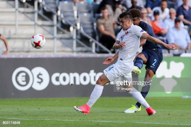 Robert Mazan of Slovakia and Mason Holgate of England battle for the ball during the 2017 UEFA European Under21 Championship match between Slovakia...
