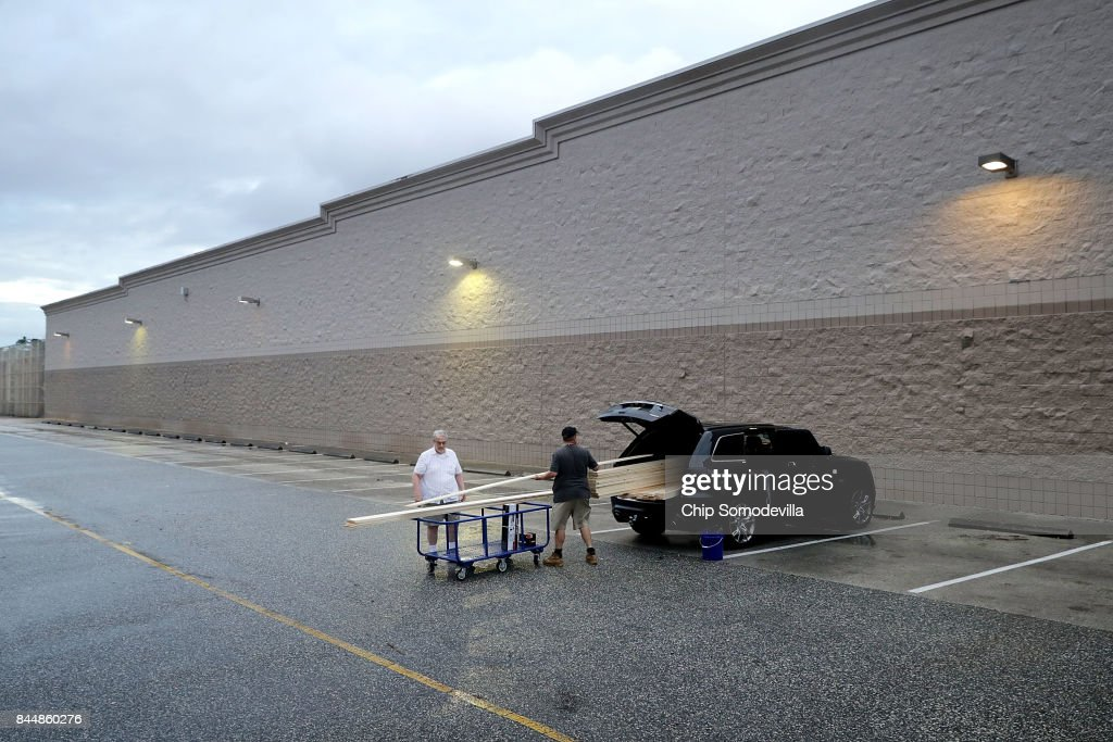 Robert McCarthy (L) helps his son Brian McCarthy load lumber they plans to use to protect his home ahead of the arrival of Hurricane Irma outside the Lowes September 9, 2017 in Port Orange, Florida. Governor Rick Scott has ordered the mandatory evacuation of millions of people from the southern part of the state ahead of the unprecedented storm.