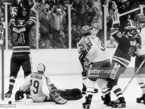 Robert McClanahan raises his arms after scoring the third and deciding goal for the American Olympic hockey team against Finland's goalie Jorma...