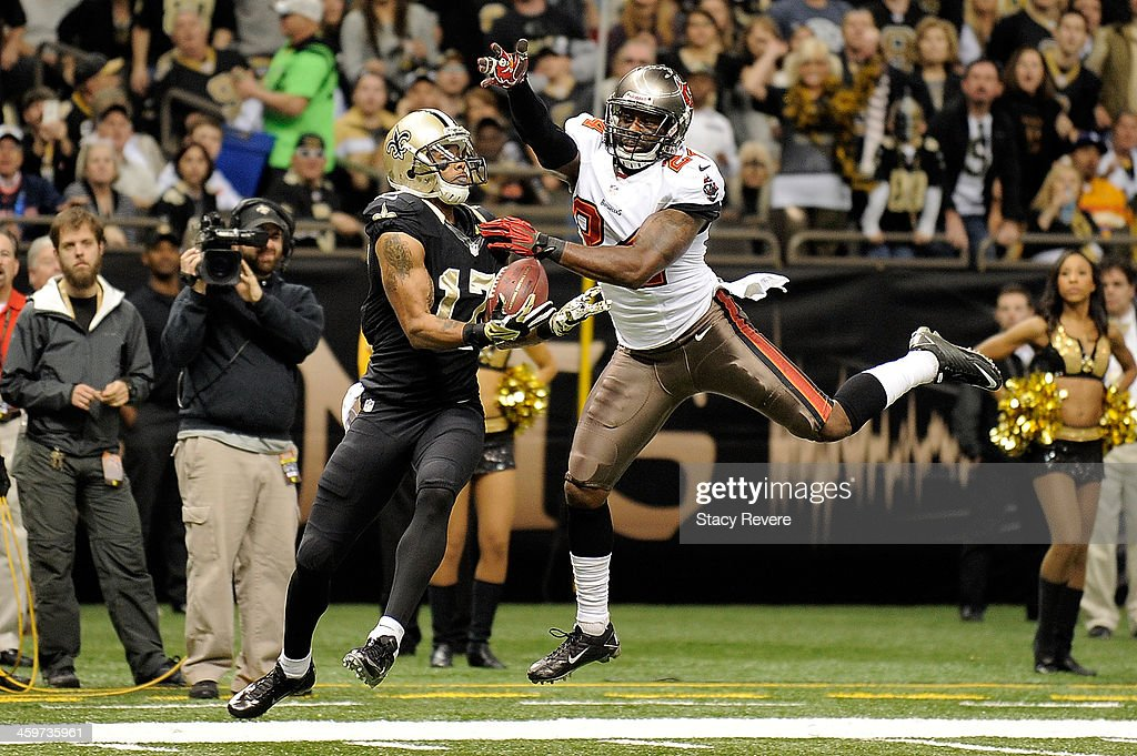 Robert Meachem #17 of the New Orleans Saints catches a pass for a touchdown in front of Darrelle Revis #24 of the Tampa Bay Buccaneers during a game at the Mercedes-Benz Superdome on December 29, 2013 in New Orleans, Louisiana.