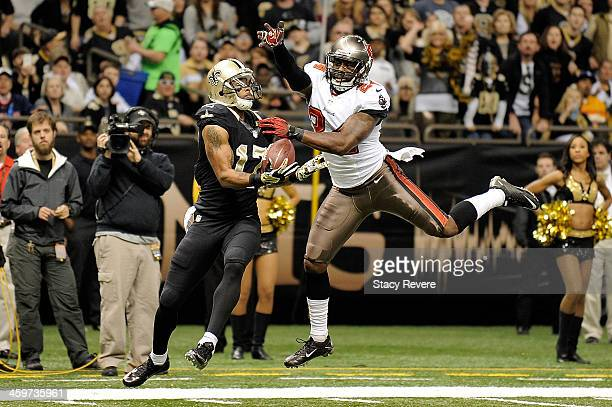 Robert Meachem of the New Orleans Saints catches a pass for a touchdown in front of Darrelle Revis of the Tampa Bay Buccaneers during a game at the...