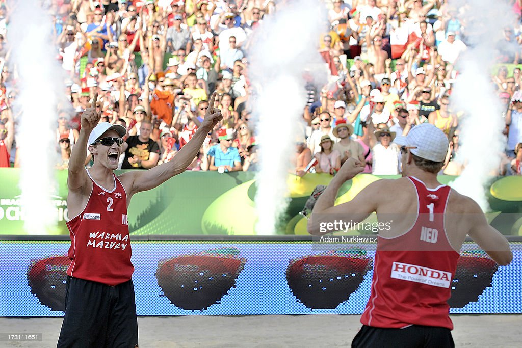 Robert Meeuwsen (L) and Alexander Brouwer (R) of the Netherlands celebrate after winning a point and their victory during the men's final match between the Netherlands and Brazil during Day 7 of the FIVB World Championships on July 7, 2013 in Stare Jablonki, Poland.