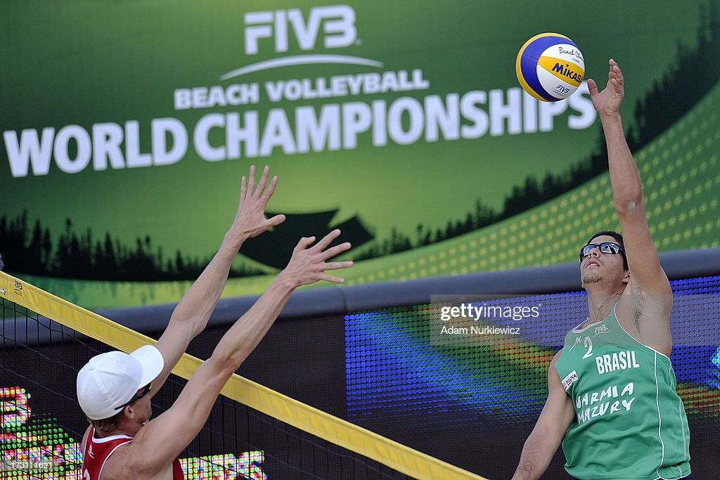 Robert Meeuwsen (L) of the Netherlands blocks against Alvaro Morais Filho (R) of Brazil during the men's final match between the Netherlands and Brazil during Day 7 of the FIVB World Championships on July 7, 2013 in Stare Jablonki, Poland.