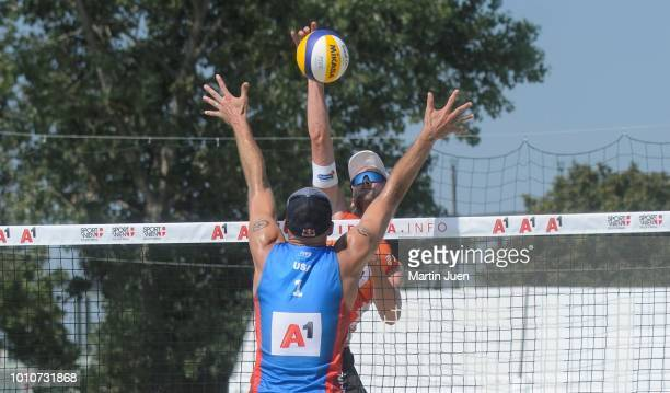 Robert Meeuwsen of the Netherlands brings the ball over the net during match im the men's round of 16 between Predo Solberg Salgado of Brazil and...
