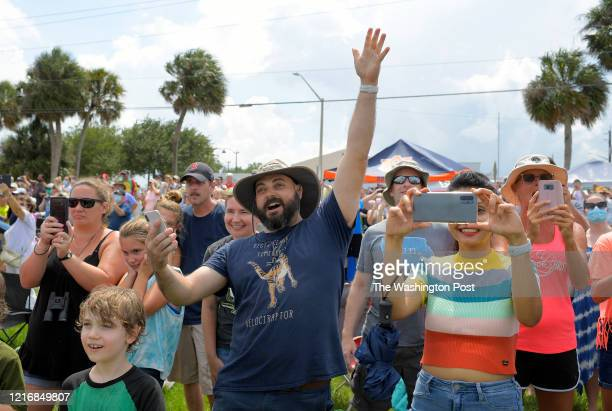 Robert Meissner of Seminole FL concludes giving a count down for the crowd on the banks of the Inidan River watching the Space X manned flight take...