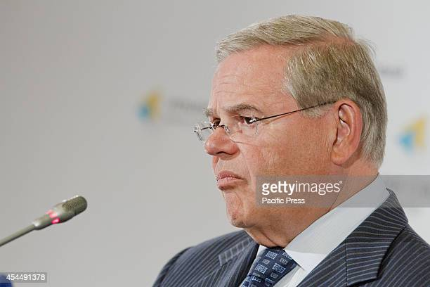 Robert Menendez the US Senator of New Jersey Democratic party and Chairman of the Senate Foreign Relations Committee listens during a press...