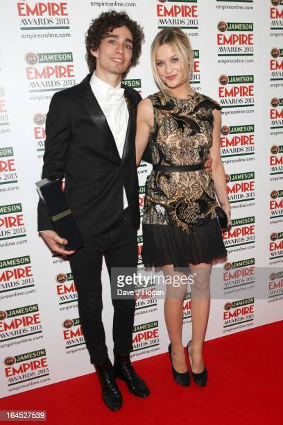Robert Michael Sheehan and Laura Whitmore pose in the press room at the Jameson Empire Awards 2013 at Grosvenor House Hotel on March 24 2013 in...