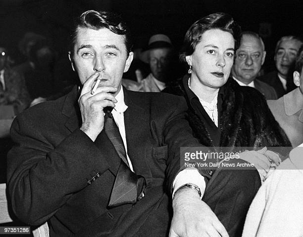 Robert Mitchum and his wife Dorothy at the MarcianoMoore fight at Yankee Stadium