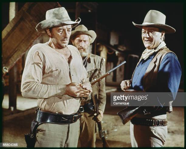 Robert Mitchum Arthur Hunnicutt and John Wayne together in a scene from the Howard Hawks directed western El Dorado 1966
