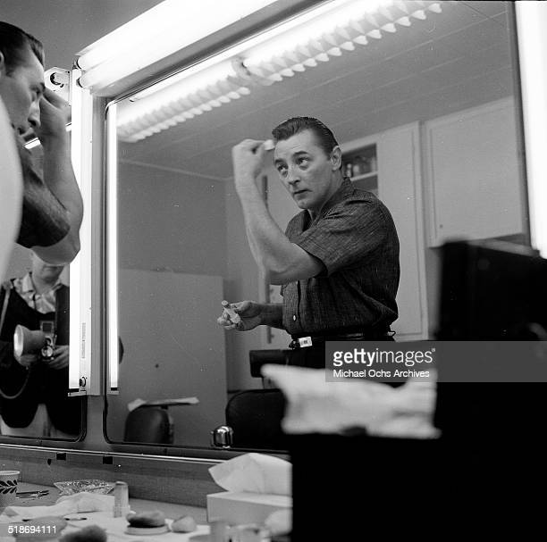 Robert Mitchum gets ready to appear on the Jimmy Durante Show in Los AngelesCA