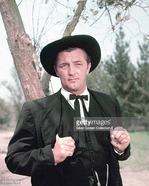 Robert Mitchum US actor in period costume as a preacher in a publicity portrait issued for the film 'The Night of the Hunter' 1955 The thriller...