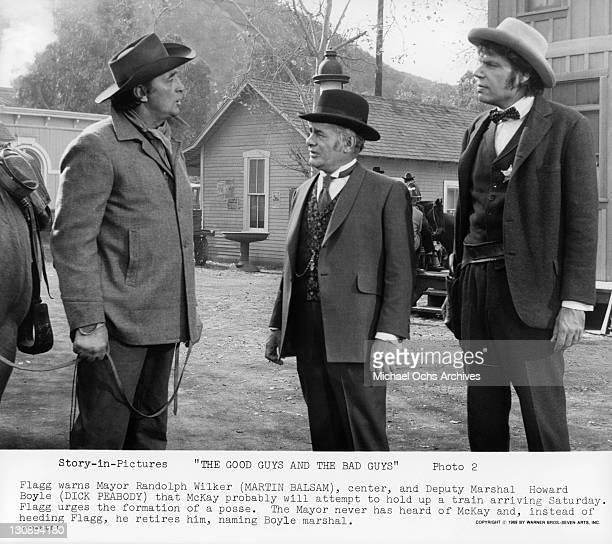 Robert Mitchum warns Martin Balsam and Dick Peabody that outlaw will attempt to hold up a train in a scene from the film 'The Good Guys And The Bad...