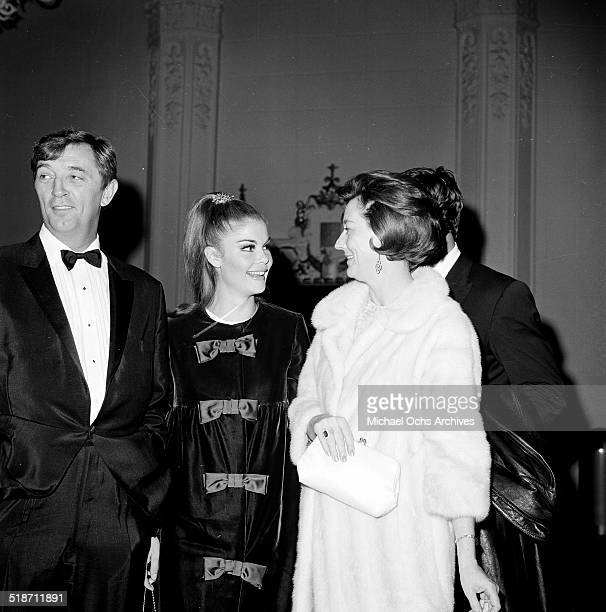 Robert Mitchum, Wende Wagner and his wife Dorothy attend an event in Los Angeles,CA.