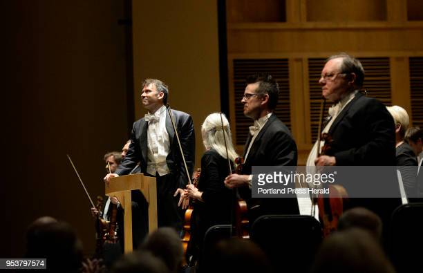 Robert Moody conductor of the Portland Symphony Orchestra acknowledges the crowd as they give him a standing ovation after he performs his final...