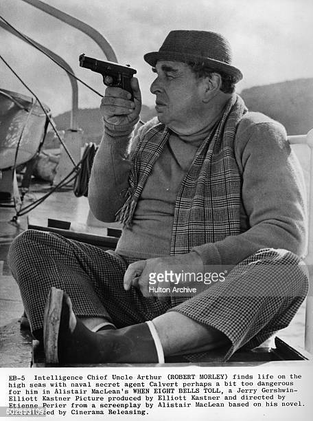 Robert Morley looks through his gun in a scene for the movie 'When Eight Bells Toll' circa 1970