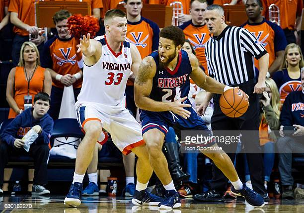 Robert Morris Aaron Tate looks for an open man during an NCAA basketball game between the Virginia Cavaliers and the Robert Morris Colonials on...