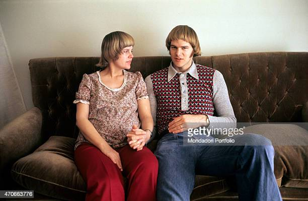 'Robert Morse American basketball player sitting on the sofa of his house hand in hand with his wife Jane pregnant of their first daughter Jennifer...