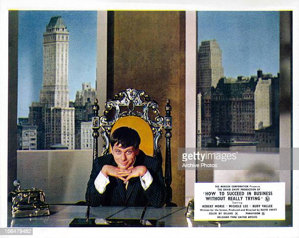 Robert Morse sitting at a business desk in a scene from the film 'How To Succeed In Business Without Really Trying' 1967