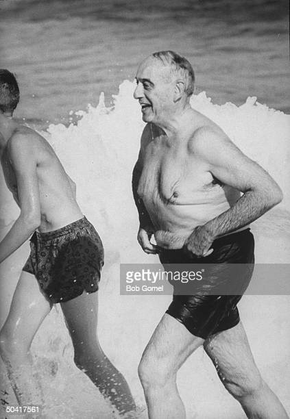 Robert Moses head of the New York World's Fair playing at the beach