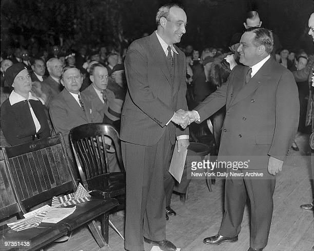 Robert Moses Republican candidate for Governor and Mayor Fiorello LaGuardia shake hands at last night's final rally in Madison Square Garden