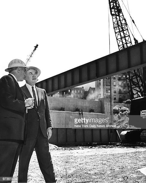 Robert Moses Triborough Bridge and Tunnel Authority boss and Austin Tobin Port Authority head watch hoisting of girder at scene of construction of a...