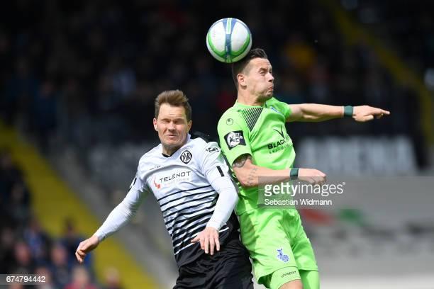 Robert Mueller of Aalen and Stanislav Iljutcenko of Duisburg jump for a header during the third league match between VfR Aalen and MSV Duisburg at...