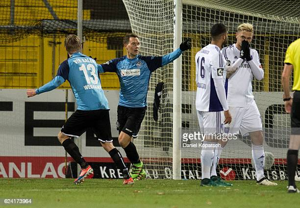 Robert Mueller of Aalen celebrates his team's first goal with team mates during the third league match between VfR Aalen and VfL Osnabrueck at...