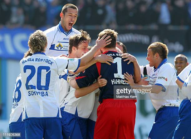 Robert Mueller of Rostock jubilates with team mates after scoring the first goal during the Third League match between FC Hansa Rostock and SG Dynamo...
