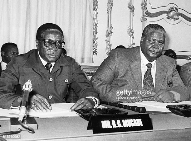 Robert Mugabe and Joshua Nkomo leaders of the Zimbabwe Patriotic Front hold a conference in London with British politicians to discuss the future of...