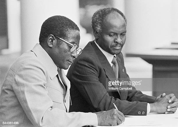 Robert Mugabe and Zimbabwe President Canaan Banana attend the ceremony for the independence of Zimbabwe