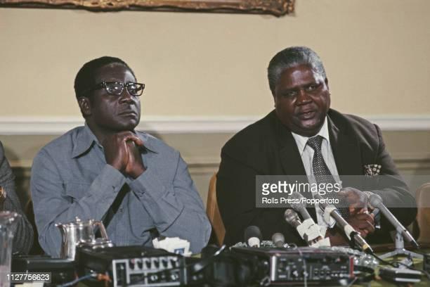 Robert Mugabe leader of the Zimbabwe African National Union pictured on left with Joshua Nkomo leader of the Zimbabwe African Peple's Union at a...