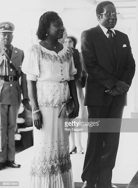 Robert Mugabe the Prime Minister of Zimbabwe visits the Queen at Buckingham Palace with his wife Sally 20th May 1982