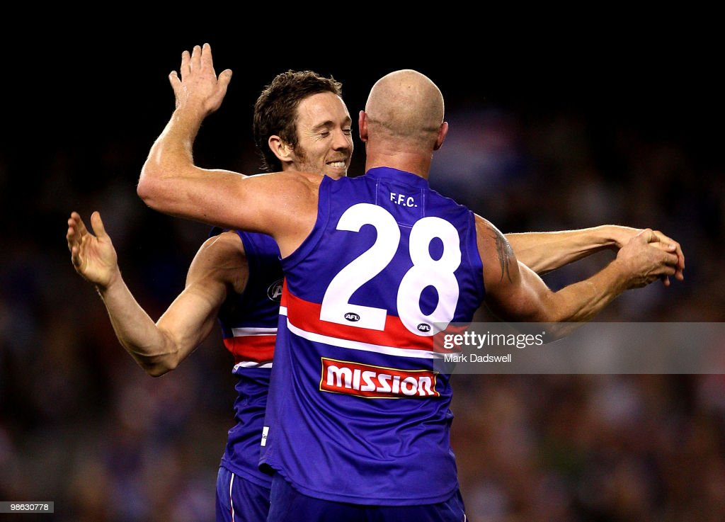 Robert Murphy and Barry Hall of the Bulldogs celebrate a goal during the round five AFL match between the Western Bulldogs and the Adelaide Crows at Etihad Stadium on April 23, 2010 in Melbourne, Australia.