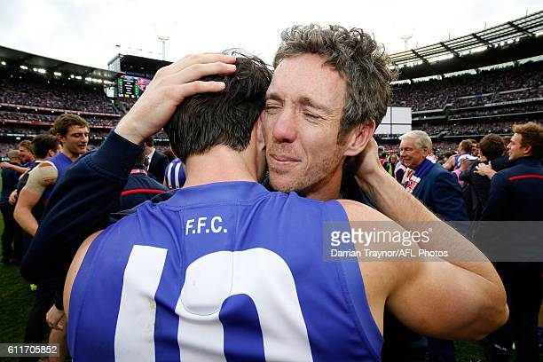 Robert Murphy and Easton Wood of the Bulldogs embrace after the 2016 AFL Grand Final match between the Sydney Swans and the Western Bulldogs at...