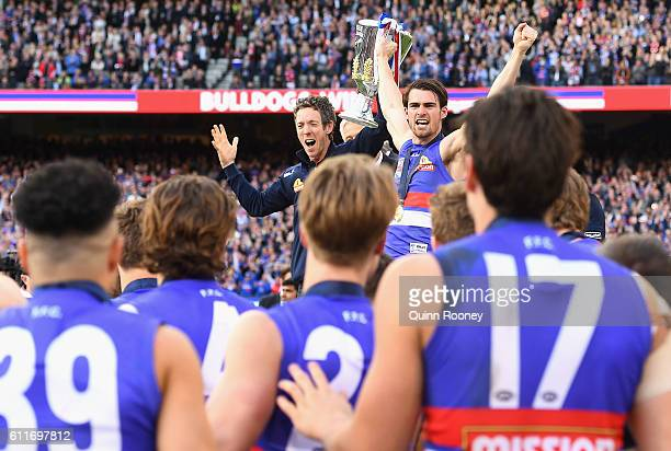 Robert Murphy and Easton Wood of the Bulldogs hold up the Premiership Cup to their team during the 2016 AFL Grand Final match between the Sydney...