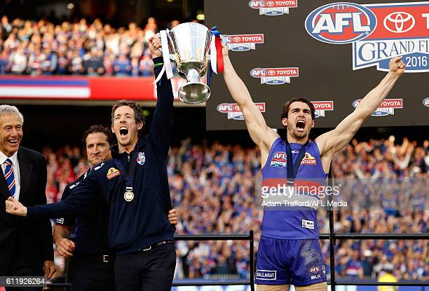 Robert Murphy and Easton Wood of the Bulldogs hold up the the premiership cup during the 2016 Toyota AFL Grand Final match between the Sydney Swans...