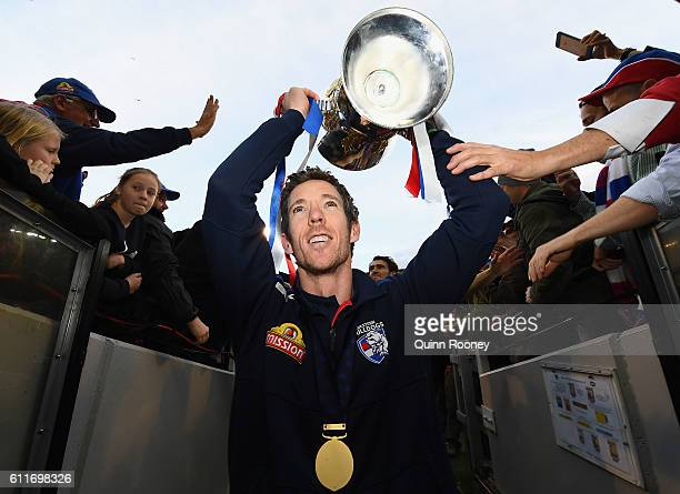 Robert Murphy of the Bulldogs celebrates with the trophy as he walks down the race after winning the 2016 AFL Grand Final match between the Sydney...